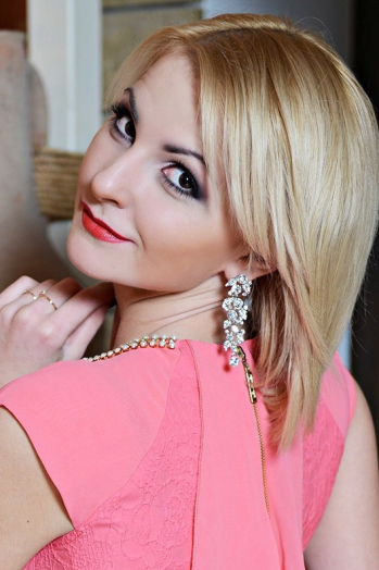 Ukrainian girl Kristina,24 years old with brown eyes and blonde hair.