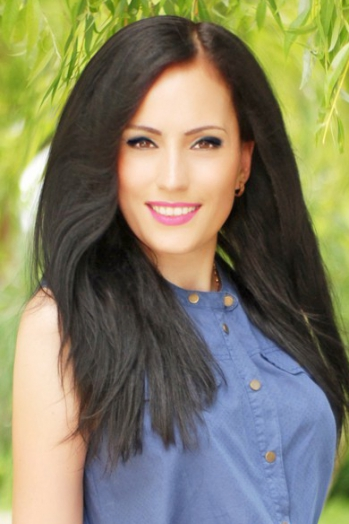Ukrainian girl Lyubov ,38 years old with brown eyes and black hair.
