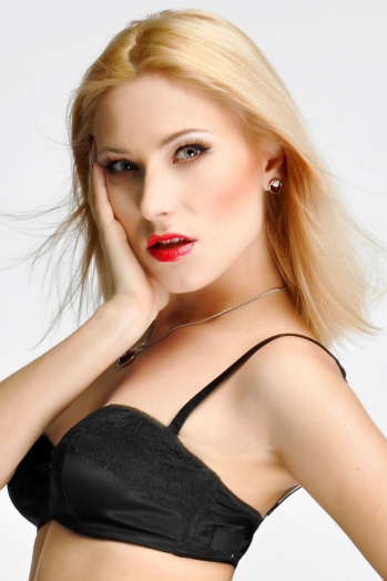 Ukrainian girl Svitlana,30 years old with green eyes and blonde hair.