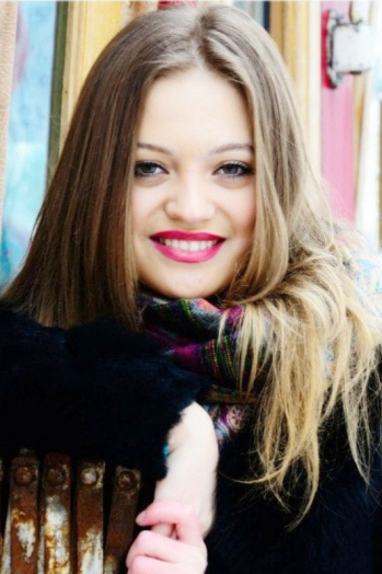 Ukrainian girl Marina,22 years old with green eyes and light brown hair.