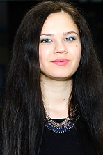 Ukrainian girl Evgeniya,22 years old with green eyes and dark brown hair.