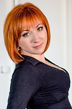 Ukrainian girl Juliya,32 years old with grey eyes and red hair.