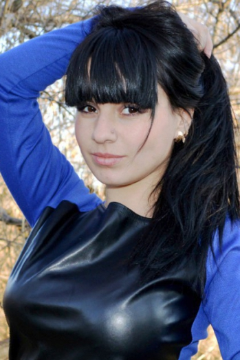 Ukrainian girl Yuliya,26 years old with brown eyes and black hair.