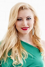 Ukrainian girl Olga,27 years old with green eyes and blonde hair.