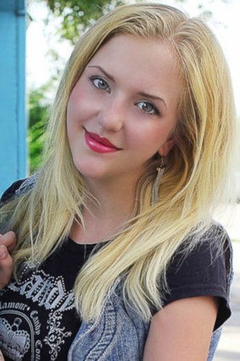 Ukrainian girl Alexa,22 years old with grey eyes and blonde hair.