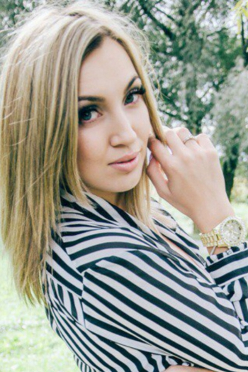 Ukrainian girl Zoya,23 years old with blue eyes and blonde hair.