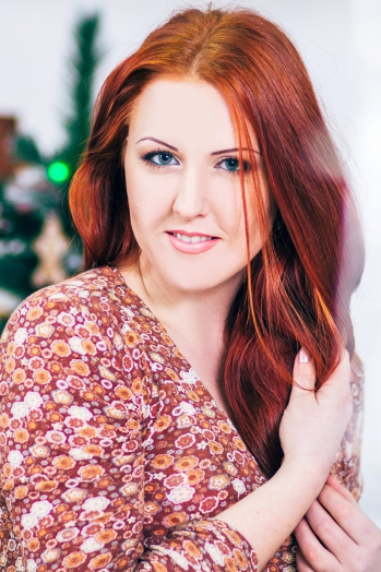 Ukrainian girl Irina,27 years old with blue eyes and red hair.