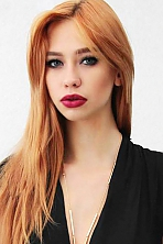 Ukrainian girl Oksana,25 years old with green eyes and red hair.