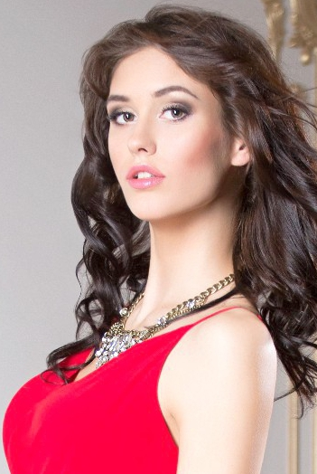 Ukrainian girl Caroline,22 years old with green eyes and dark brown hair.