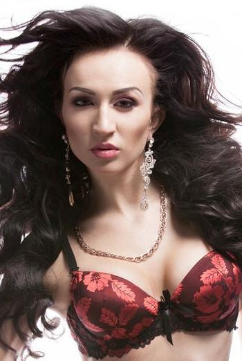 Ukrainian girl Mariana,23 years old with brown eyes and dark brown hair.