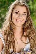 Ukrainian girl Karina,21 years old with green eyes and light brown hair.