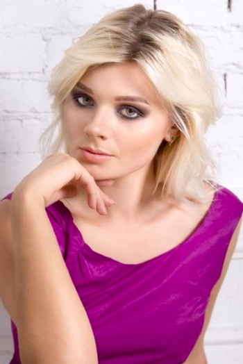 Ukrainian girl Elena,25 years old with green eyes and blonde hair.