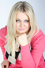 Ukrainian girl Oxana,33 years old with green eyes and blonde hair.