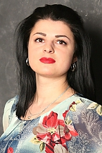 Ukrainian girl Ekaterina,24 years old with brown eyes and black hair.