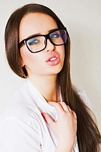 Ukrainian girl Arina,22 years old with grey eyes and light brown hair.