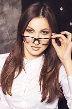 Ukrainian girl Alena,23 years old with brown eyes and dark brown hair.