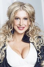Ukrainian girl Anastasia,30 years old with brown eyes and blonde hair.