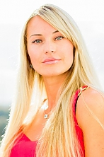 Ukrainian girl Elena,34 years old with blue eyes and blonde hair.