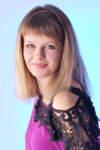 Ukrainian girl Khrystyna,27 years old with green eyes and light brown hair.