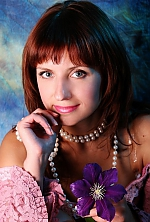 Ukrainian girl Olga,33 years old with green eyes and light brown hair.