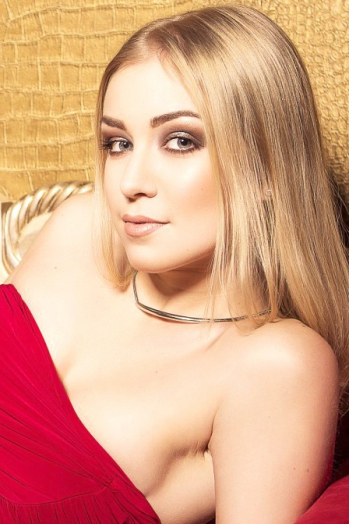 Ukrainian girl Olya,23 years old with grey eyes and blonde hair.