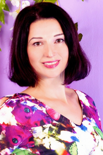 Ukrainian girl Ludmila,44 years old with brown eyes and dark brown hair.