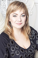 Ukrainian girl Lyudmila,39 years old with blue eyes and blonde hair.