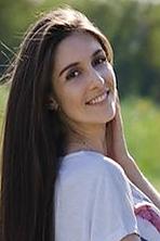 Ukrainian girl Olga,26 years old with hazel eyes and dark brown hair.