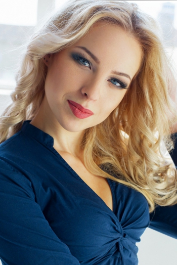 Ukrainian girl Ekaterina,21 years old with blue eyes and blonde hair.
