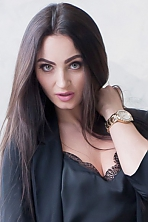Ukrainian girl Anna,26 years old with green eyes and dark brown hair.