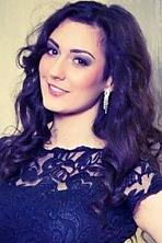 Ukrainian girl Galina,23 years old with green eyes and black hair.