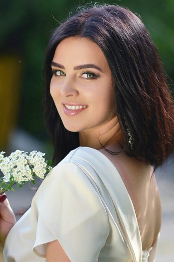 Ukrainian girl Nataliya,22 years old with green eyes and dark brown hair.