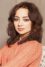 Ukrainian girl Julia ,37 years old with brown eyes and dark brown hair.