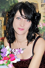 Ukrainian girl Julia,34 years old with blue eyes and black hair.