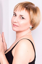 Ukrainian girl Irina,36 years old with green eyes and light brown hair.
