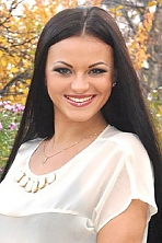 Ukrainian girl Olga,26 years old with green eyes and black hair.