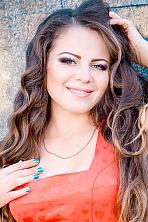 Ukrainian girl Marina,23 years old with green eyes and dark brown hair.