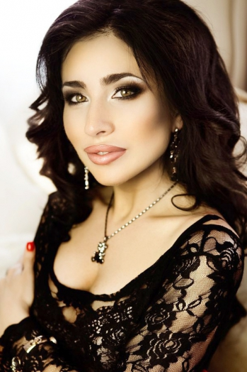 Ukrainian girl Valery,32 years old with green eyes and black hair.