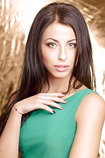 Ukrainian girl Tatjana,19 years old with green eyes and black hair.
