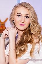 Ukrainian girl Olga,21 years old with blue eyes and blonde hair.