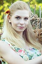 Ukrainian girl Larisa,21 years old with green eyes and blonde hair.