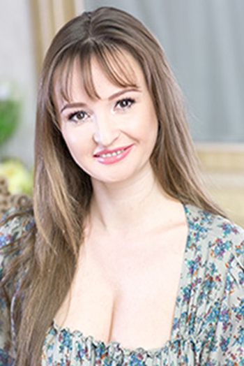 Ukrainian girl Elena,35 years old with hazel eyes and light brown hair.