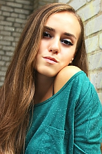 Ukrainian girl Olga,20 years old with grey eyes and light brown hair.
