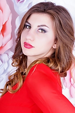 Ukrainian girl Mayya,22 years old with brown eyes and light brown hair.