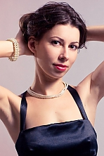 Ukrainian girl Julia,32 years old with hazel eyes and light brown hair.