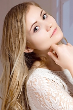 Ukrainian girl Zoe,20 years old with green eyes and blonde hair.