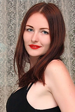 Ukrainian girl Olga,28 years old with blue eyes and light brown hair.