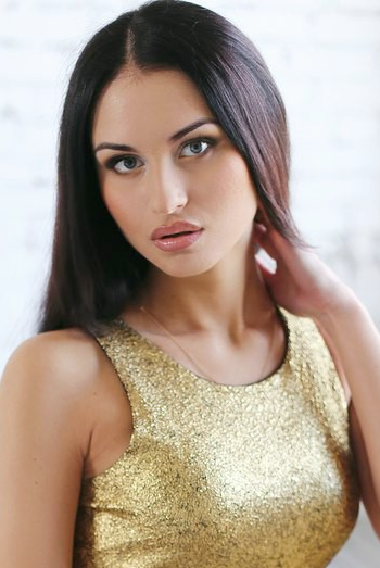 Ukrainian girl Yulia,27 years old with blue eyes and black hair.