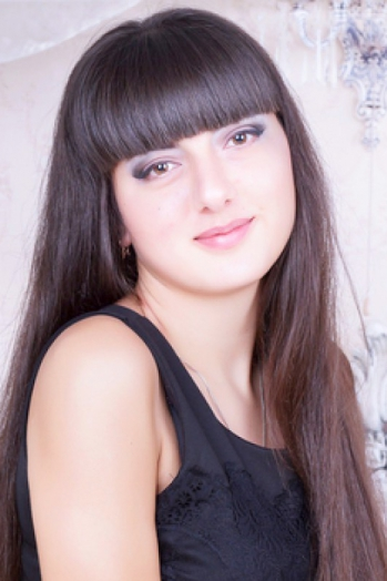 Ukrainian girl Anastasia,19 years old with brown eyes and dark brown hair.