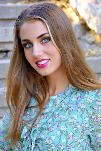 Ukrainian girl Julia,26 years old with green eyes and light brown hair.